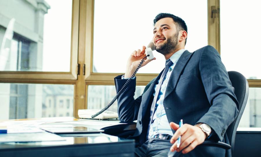 Man at his desk happy