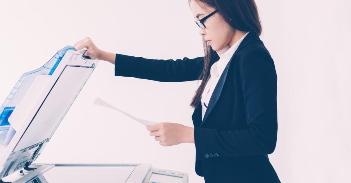 woman using multifunction copier