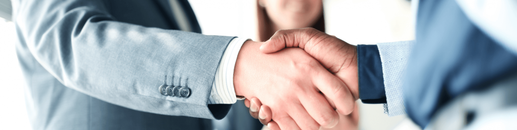 Two business colleagues shaking hands